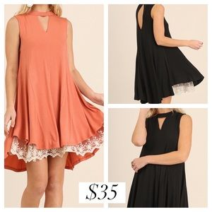 Umgee swing dress with keyhole closure. True fit.